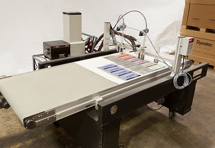 custom build adhesive application system with conveyor belt and ITW Dynatec Quattro Challenger glue machine with automated double spray